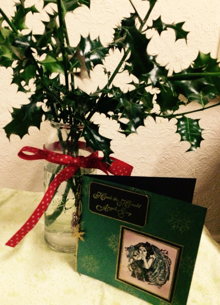 holly branches in a ribbon tied jar and a greeting card inkdrops.co.uk